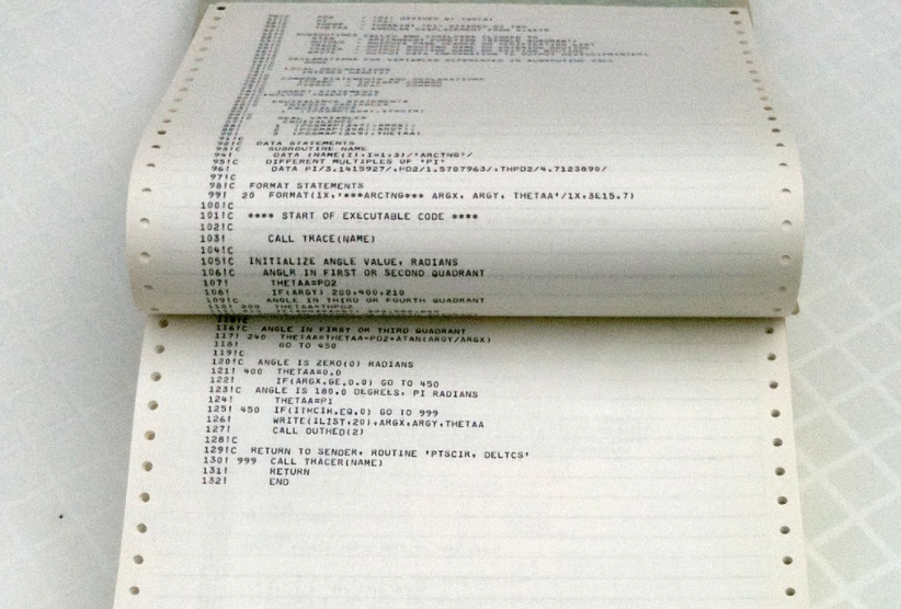 A line printer listing of a large computer program from 1978, bound in a printout binder.